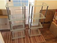 Bathroom free standing chrome and glass shelve units. Two number.