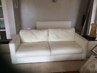 2 large cream leather look sofas with foot stool, happy to sell together or split