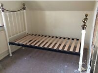 Cream cast iron style vintage bed