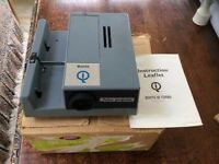 Boots 35mm slide projector with simple manual operation taking strip and circular carosels