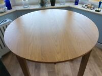 Oak effect round dining table. Diameter 100cm.
