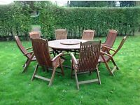 Large teak garden table eight 8 recliner chairs and lazy suzzie.