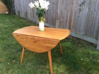 Oval folding elm Ercol dining table