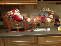 Santa and Reindeer in a sleigh