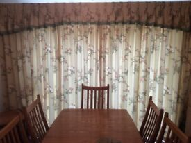 Two pairs of Professionally made curtains and valance with curtain tracks, in good condition
