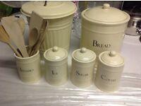 Set of kitchen storage jars and bins.