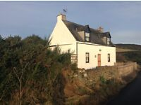 Scottish Holiday Cottage with wonderful sea views of the Moray Firth and Helmsdale. Sleeps 4-5
