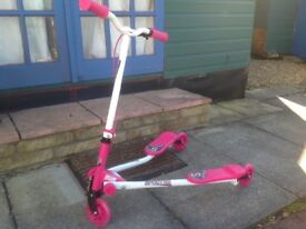 Girl's pink and white Flicker with flashing front wheel. Only been used twice