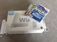 Nintendo Wii, with 2 remotes, 1 nunchuck, 4 games plus wifi fit balance board and game
