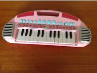 Small pink piano with new battery good working order