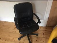 Black swivel desk chair with casters
