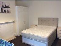 Room to let in spacious Town house.