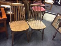 A pair of retro dining chairs