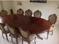 Excellent condition this beautiful Italian inlaid dining table with 2 carvers and 6 dining chairs