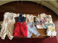 Bundle of baby clothes, size newborn, hardly used.