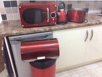 Red microwave, kettle, toaster ,bread bin and peddel bin good as new