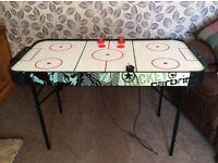 Air hockey games table.