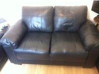 Black Italian leather two seater sofas