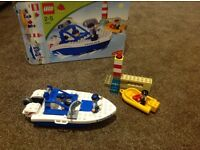 Lego duplo set 4861 Police boat, 2 policeman, lighthouse, dinghy and robber. Box complete as new.