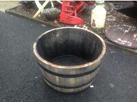 Half oak barrel planters for garden patio
