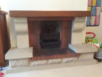 Stone and brick fireplace surround for sale.