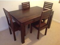 Chunky dark wood dining table with 4 chairs