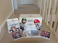 New Nintendo Wii in box with games and Accessories