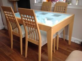 Calligaris dining table with four chairs plus two matching chairs