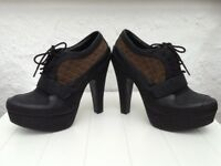 Red Herring Platform Heels. Brand new with tags. Size 7.