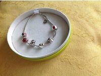 Genuine Miss Chamilia girls real silver, hallmarked charm bracelet, boxed.
