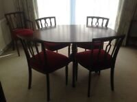 Dining table with 6 chairs in mahogany