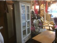 Tall glass cupboard