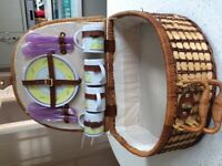 Wicker picnic basket with plate and cups etc