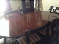 Dark wood extending table and chairs