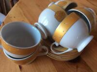 Six coffee cups and saucers
