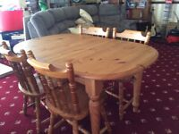 Extending pine kitchen dining room table and 4 chairs