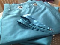 Teal full-length eyelet curtains and tie backs