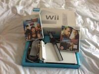 Nintendo Wii with games.