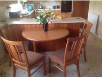 SOLID WOOD CIRCULAR FOLDING LEAF DINING TABLE AND 4 CHAIRS - MADE IN THE UK - IMMACULATE CONDITION