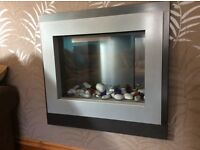 Stylish wall mounted electric fire place. Remote controlled.