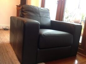 Two Black Faux Leather Armchairs
