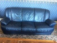 Dark blue leather settees, 1 x 3 seater, 1 x 2 seater, armchair and footstool