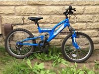 Boys blue TFS.20 TRAX bike. Would suit age 5-7 years old.
