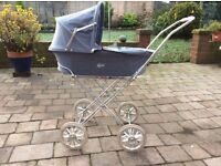 """Lovely """"LUXI"""" dolls pram. Very good condition. Suit 5+. detachable cot. Folding chassis"""