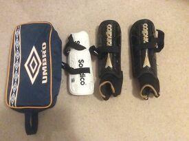 Football shin guards and bag