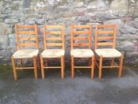 Four rush seated pine dining chairs