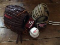 Adult and child's baseball gloves