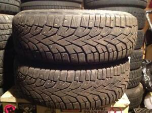 2 pneus d'hiver à clous 215/70 r16 gislaved nord frost 100.... 120$