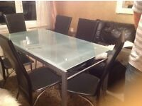 Beautiful dinning table and 6 black leather chairs