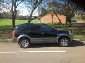 Black automatic Kia Sorento